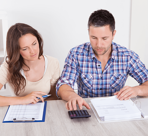 Down Payment Options You Can Take Advantage Of Couple Calculating Image